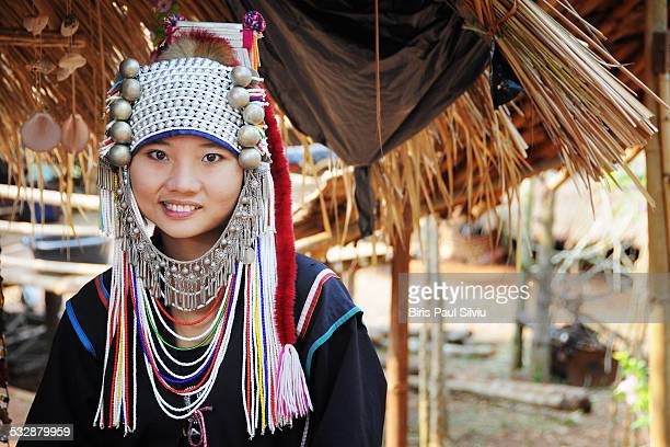 Akha woman in northern Thailand The Akha are an indigenous hill tribe who live in small villages at higher elevations in the mountains of Thailand...