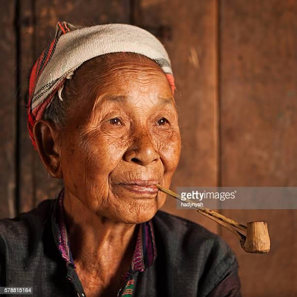 Akha woman smoking a pipe in Northern Laos