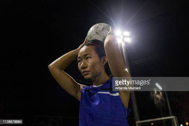 Akha/Thai Woman Soccer Player Throwing a Ball