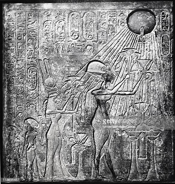 Akhenaten heretic pharaoh reigned from c150 BC here with Nefertiti and their two daughters offering gifts to the Sun Relief originally in Temple of...