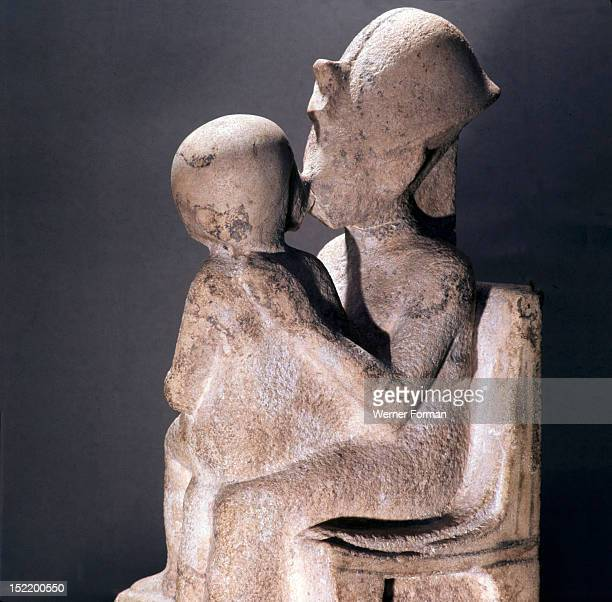 Akhenaton kisses his daughter as she sits on his lap An unfinished statue Egypt Ancient Egyptian Amarna period c 1373 1357 BC Tell el Amarna