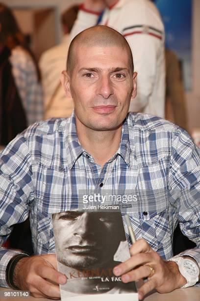 Akhenaton signs copies of his book at the 30th salon du livre at Porte de Versailles on March 28 2010 in Paris France