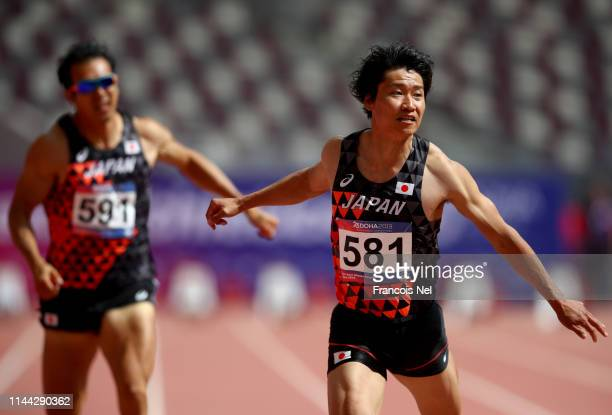Akhiko Nakamura of Japan and Keisuke Ushiro of Japan compete in the men's decathlon 100m heats during day two of the 23rd Asian Athletics...
