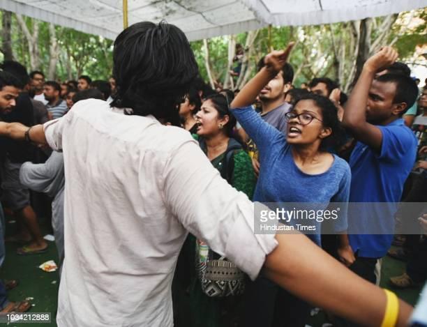 Akhil Bharatiya Vidyarthi Parishad supporters clash at the counting center during the Jawaharlal Nehru University Students Union elections at JNU on...