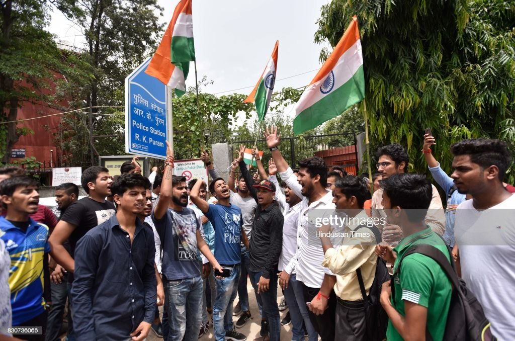 Akhil Bharatiya Vidyarthi Parishad (ABVP) supporters protest against All India Students' Association (AISA) at South Campus Police Station, on August 12, 2017 in New Delhi, India.