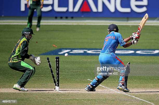 Akhil Herwader of India is bowled by Karamat Ali of Pakistan during the ICC U19 Cricket World Cup 2014 match between India and Pakistan at the Dubai...