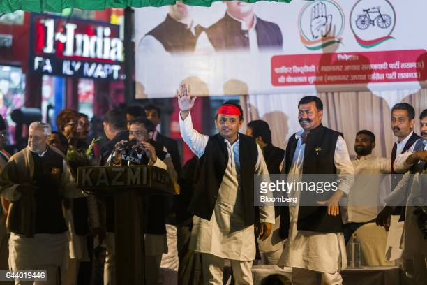 Akhilesh Yadav chief minister of the state of Uttar Pradesh and president of the Samajwadi Party center waves during a state election rally in...