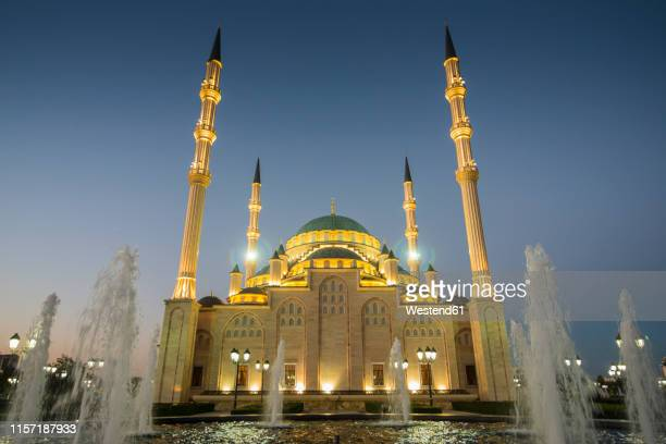akhmad kadyrov mosque after sunset, grozny, chechnya - tschetschenien stock-fotos und bilder