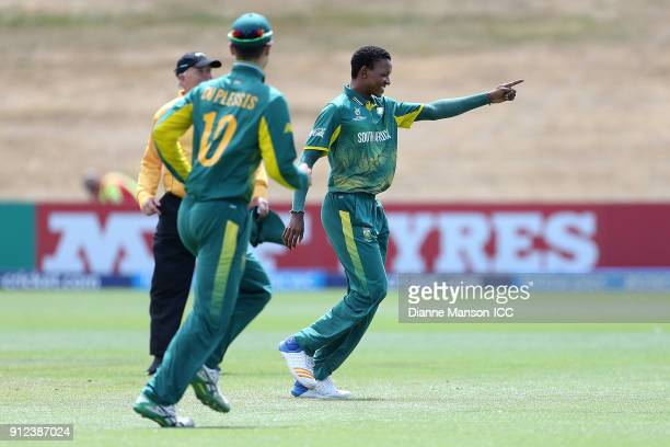 Akhona Mnyaka of South Africa celebrates the dismissal of Afif Hossain Dhrubo of Bangladesh during the ICC U19 Cricket World Cup 5th Playoff match...