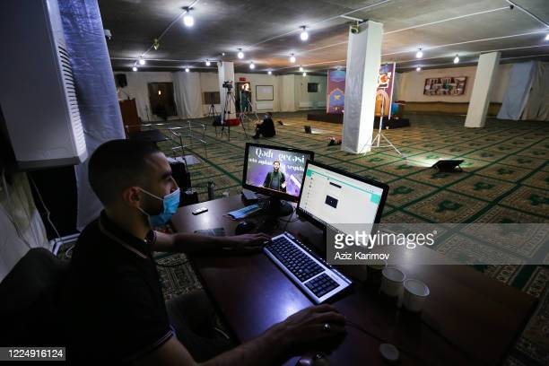 Akhund of the FatimeyiZahra mosque Haji Surkhay livestreams via social media for the Muslim community to pray from home during Lailat alQadr on May...