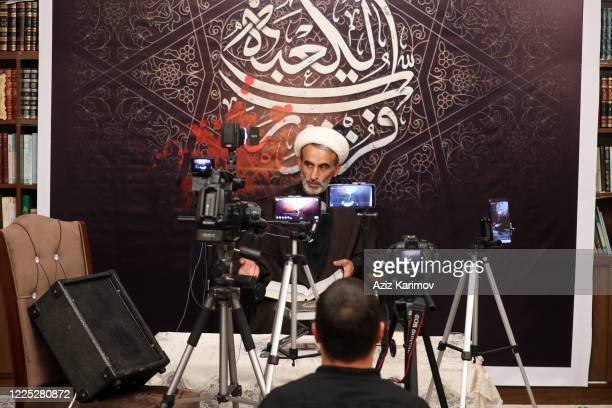 Akhund of the Haji Javad mosque Haji Ahliman Rustamov livestreams via social media from his home for the Muslim community to pray from home during...