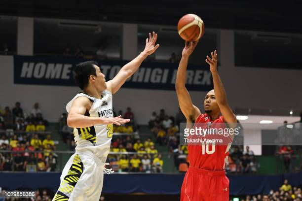 Aki Chambers of the Chiba Jets shoots while under pressure from Kenta Hirose of the Sun Rockers Shibuya during the B.League Early Cup Kanto 3rd Place...