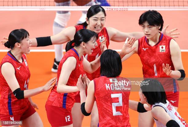 Aki Momii of Team Japan reacts with team mates as they compete against Team Dominican Republic during the Women's Preliminary - Pool A volleyball on...
