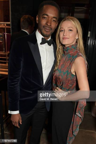 Aki Omoshaybi and Lily Travers attend the dunhill Dylan Jones PreBAFTA party at dunhill Bourdon House on January 29 2020 in London England