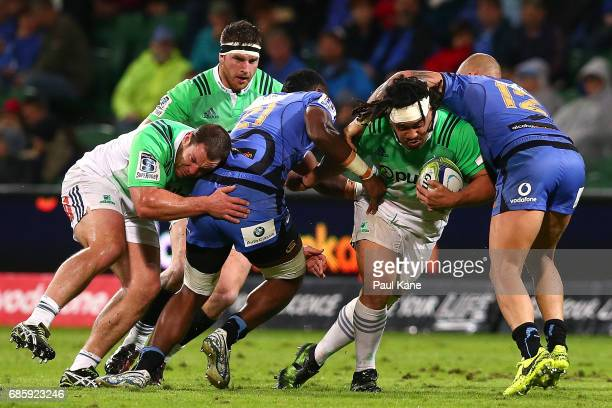 Aki Seuili of the Highlanders attempts to push thru a tackle by Isireli Naisarani and Billy Meakes of the Force during the round 13 Super Rugby match...