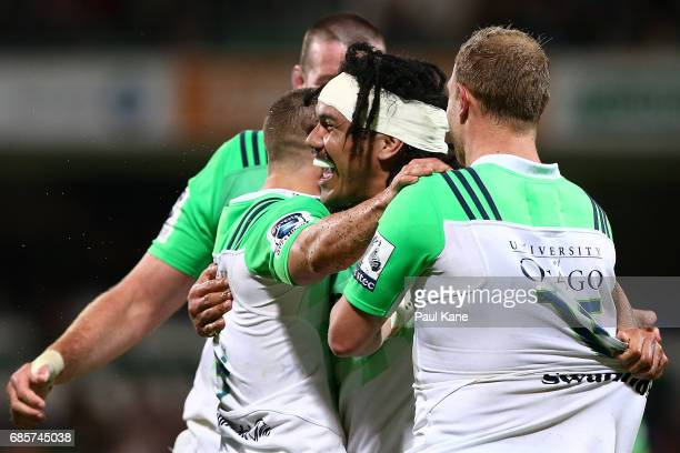 Aki Seuili of the Highlanders celebrates with team mates after crossing for a try during the round 13 Super Rugby match between the Force and the...