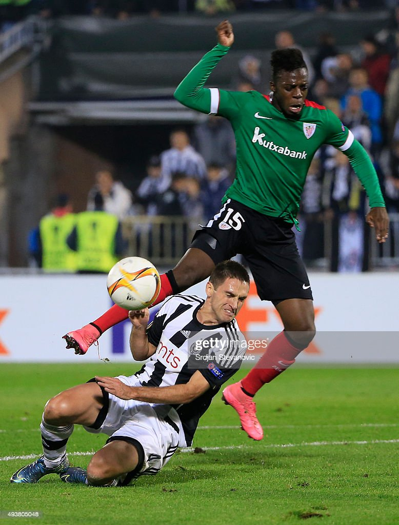 Aki Williams (R) of Athletic Club is challenged by Miroslav Vulicevic (L) of FK Partizan during the UEFA Europa League match between FK Partizan v Athletic Club at Stadium FK Partizan on October 22, 2015 in Belgrade, Serbia.