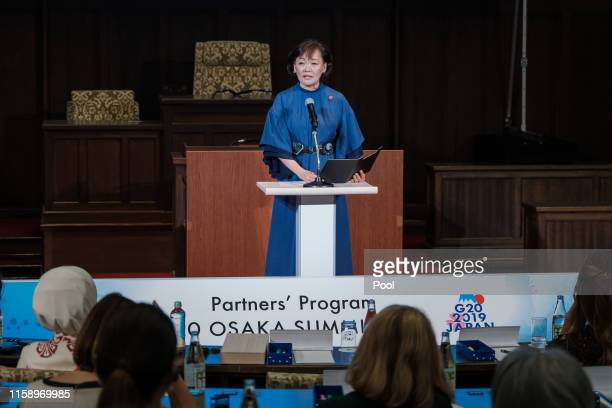 "Akie Abe, the wife of the Japanese Prime Minister delivers an opening speech during a symposium ""Ocean a precious resource for our lives"" at Osaka..."