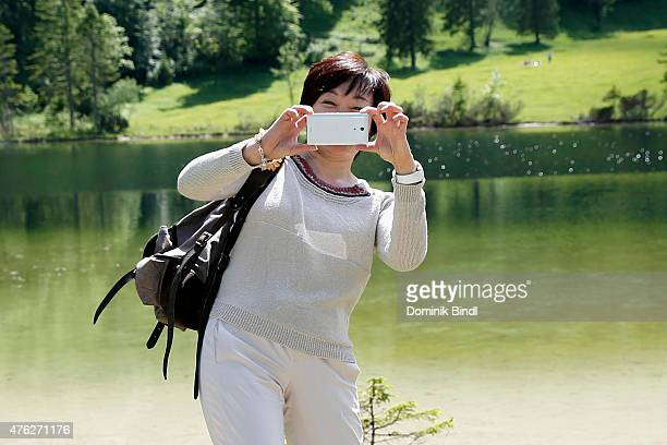 Akie Abe wife of Japanese Prime Minister Shinzo Abe take a walk at Ferchensee in the Bavarian countryside around Elmau Castle on June 7 2015 in...