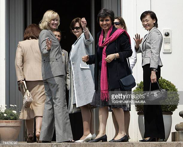 Akie Abe wife of Japanese Prime Minister Shinzo Abe waves to photographers with Laureen Harper wife of Canadian Prime Minister Stephen Harper Cherie...