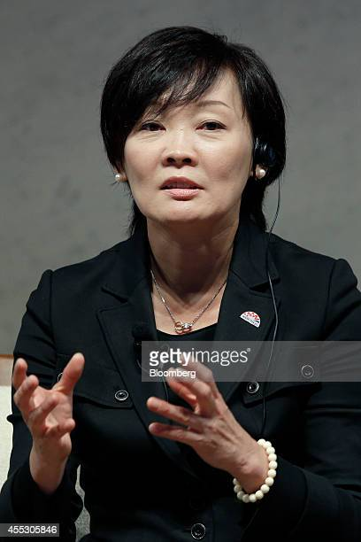 Akie Abe wife of Japan's Prime Minister Shinzo Abe speaks during a dialogue session with Cherie Blair wife of former UK Prime Minister Tony Blair and...