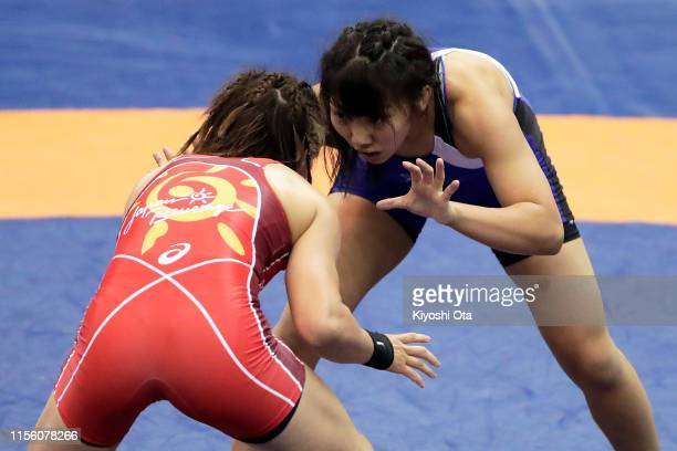 Akie Hanai competes against Risako Kawai in the Women's 57kg semifinal match on day three of the All Japan Wrestling Invitational Championships at...