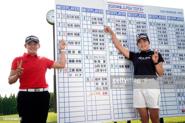Akie Iwai and Chisato Iwai of Japan point their names on the leaders' board as they celebrate passing the professional test following the final round...
