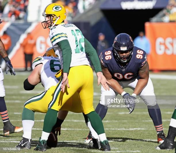 Akiem Hicks of the Chicago Bears awaits the snap against Aaron Rodgers of the Green Bay Packers at Soldier Field on December 16 2018 in Chicago...