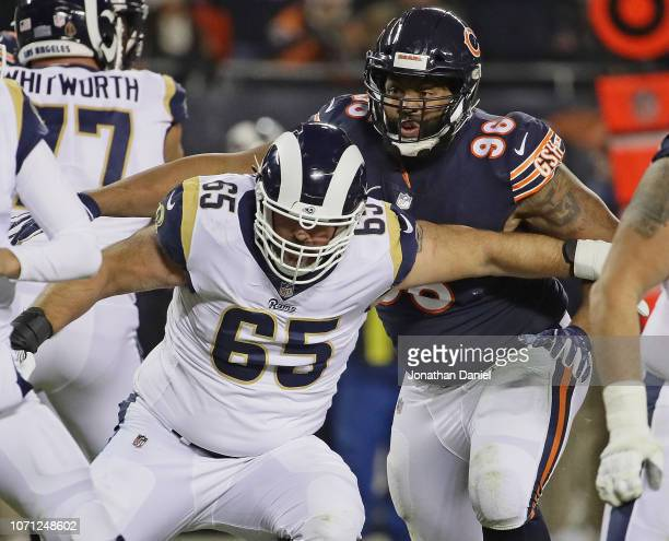 Akiem Hicks of the Chicago Bears rushes against John Sullivan of the Los Angeles Rams at Soldier Field on December 9 2018 in Chicago Illinois