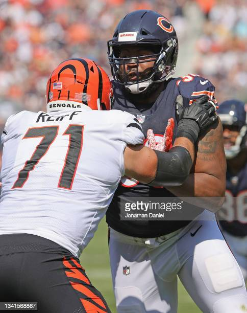 Akiem Hicks of the Chicago Bears rushes against Riley Reiff of the Cincinnati Bengals at Soldier Field on September 19, 2021 in Chicago, Illinois....