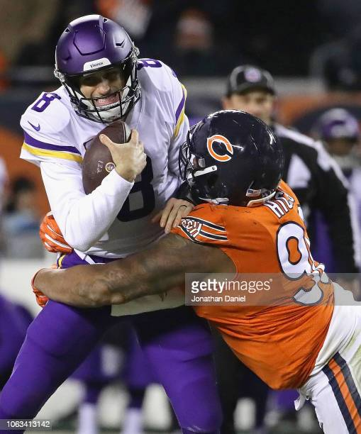 Akiem Hicks of the Chicago Bears sacks Kirk Cousins of the Minnesota Vikings at Soldier Field on November 18 2018 in Chicago Illinois The Bears...