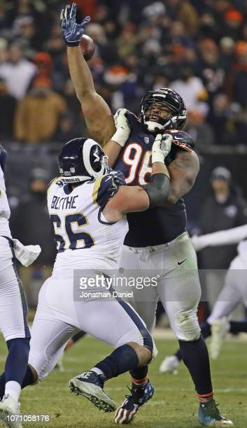 Akiem Hicks of the Chicago Bears tries to knock down a pass as he's blocked by Austin Blythe of the Los Angeles Rams at Soldier Field on December 9...