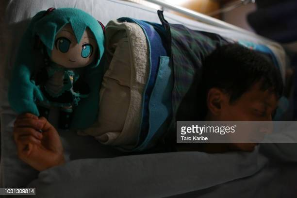 Akihiko Kondo sleeps with his favourite stuffed 'Hatsune Miku' something he has been doing for 9 years at his house on September 11 2018 in Tokyo...
