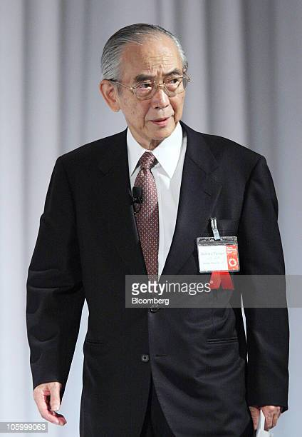 Akihiko Tembo chairman of Idemitsu Kosan Co walks to the podium at the 12th Nikkei Global Management Forum in Tokyo Japan on Monday Oct 25 2010 The...