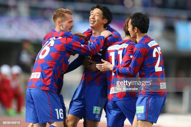 Akihiro Hyodo of Ventforet Kofu celebrates scoring the opening goal with his team mates during the J.League J1 match between Ventforet Kofu and...