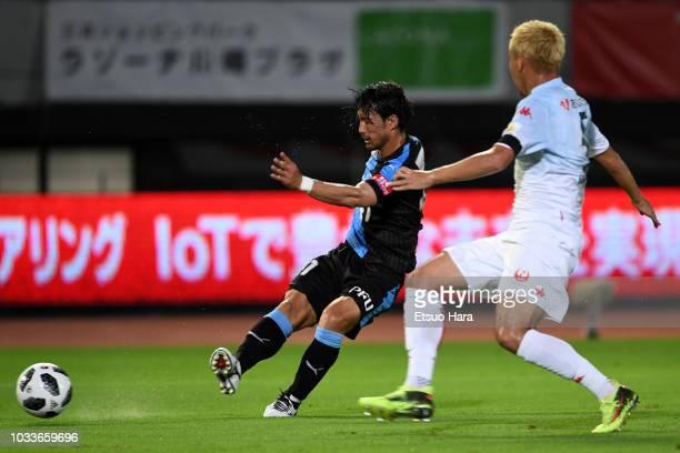 Akihiro Ienaga of Kawasaki Frontale and Akito Fukumori of Consadole Sapporo compete for the ball during the JLeague J1 match between Kawasaki...
