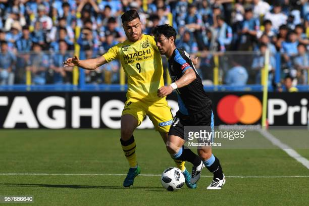 Akihiro Ienaga of Kawasaki Frontale and Cristiano of Kashiwa Reysol compete for the ball during the JLeague J1 match between Kashiwa Reysol and...