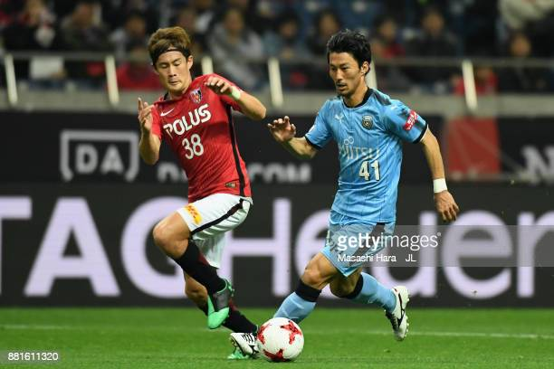 Akihiro Ienaga of Kawasaki Frontale and Daisuke Kikuchi of Urawa Red Diamonds compete for the ball during the J.League J1 match between Urawa Red...