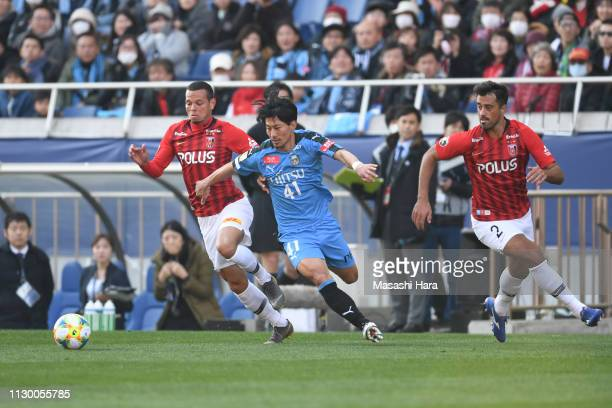 Akihiro Ienaga of Kawasaki Frontale and Ewerton of Urawa Red Diamonds compete for the ball during the Fuji Xerox Super Cup between Kawasaki Frontale...