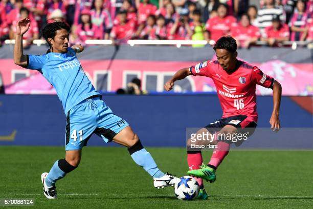 Akihiro Ienaga of Kawasaki Frontale and Hiroshi Kiyotake of Cerezo Osaka compete for the ball during the JLeague Levain Cup final match between...