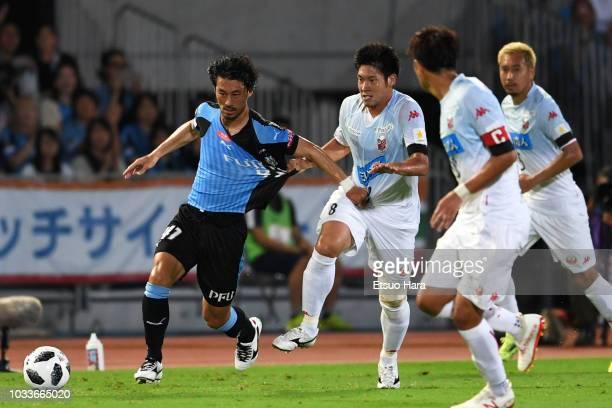 Akihiro Ienaga of Kawasaki Frontale and Kazuki Fukai of Consadole Sapporo compete for the ball during the JLeague J1 match between Kawasaki Frontale...