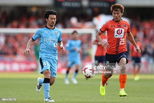 Akihiro Ienaga of Kawasaki Frontale and Kazuma Takayama of Omiya Ardija compete for the ball during the J.League J1 match between Kawasaki Frontale...