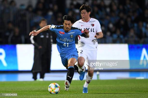 Akihiro Ienaga of Kawasaki Frontale and Koki Anzai of Kashima Antlers compete for the ball during the JLeague J1 match between Kawasaki Frontale and...