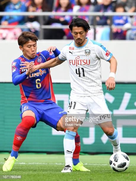 Akihiro Ienaga of Kawasaki Frontale and Kosuke Ota of FC Tokyo compete for the ball during the J.League J1 match between FC Tokyo and Kawasaki...