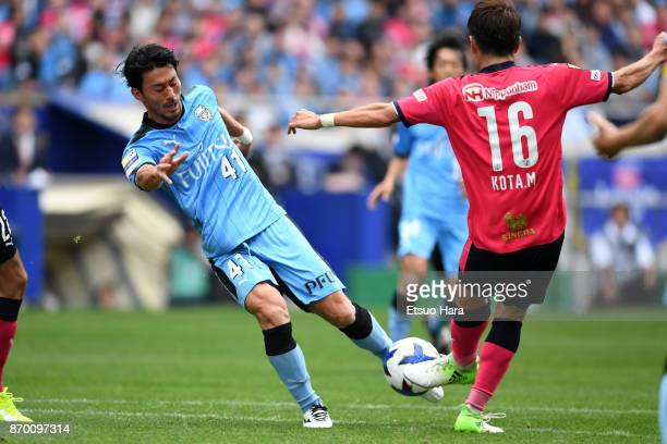 Akihiro Ienaga of Kawasaki Frontale and Kota Mizunuma of Cerezo Osaka compete for the ball during the JLeague Levain Cup final match between Cerezo...