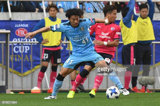 Akihiro Ienaga of Kawasaki Frontale and Riku Matsuda of Cerezo osaka compete for the ball during the JLeague Levain Cup final match between Cerezo...