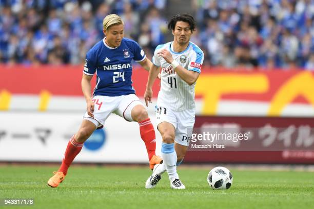 Akihiro Ienaga of Kawasaki Frontale and Ryosuke Yamanaka of Yokohama FMarinos compete for the ball during the JLeague J1 match between Yokohama...