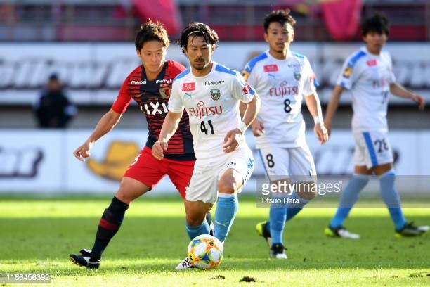 Akihiro Ienaga of Kawasaki Frontale and Ryota Nagaki of Kashima Antlers compete for the ball during the J.League J1 match between Kashima Antlers and...