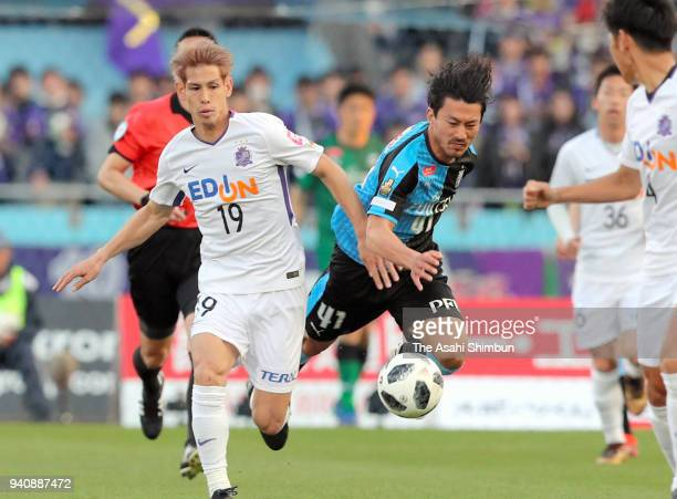 Akihiro Ienaga of Kawasaki Frontale and Sho Sasaki of Sanfrecce Hiroshima compete for the ball during the JLeague J1 match between Kawasaki Frontale...