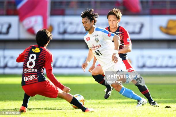 Akihiro Ienaga of Kawasaki Frontale and Shoma Doi of Kashima Antlers compete for the ball during the J.League J1 match between Kashima Antlers and...